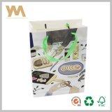 L'abitudine ha stampato il sacchetto di elemento portante di lusso di acquisto del documento del regalo del Kraft con la maniglia del cotone