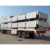 Un rimorchio delle tre degli assi di trasporto merci del carico semi