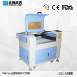 Máquina de grabado de acrílico de madera del laser de cristal para la venta