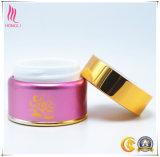 Tarro poner crema cosmético rosado de lujo con el casquillo de aluminio de oro