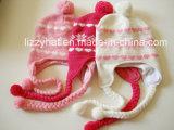 Шлем детей шерстей способа связанный жаккардом с Tassels и Earflaps