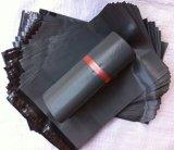 Il poli sacchetto grigio su ordinazione della posta per l'imballaggio ed esprime
