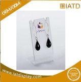 L présentoir acrylique de boucle d'oreille de Shap