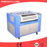 Prix en plastique de machine de découpage de gravure de laser de CO2 de forces de défense principale d'acrylique en bois