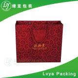 Bolso de empaquetado de papel de lujo impreso insignia de encargo Kraft de la bolsa del bolso del regalo del bolso de compras