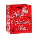 Do presente romântico listrado dos cosméticos da roupa do dia do Valentim sacos de papel