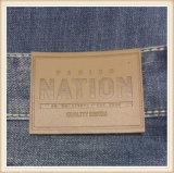 Contrassegno di cuoio su ordinazione materiale dell'unità di elaborazione e genuino impresso marchio per vestiti