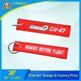 カスタム昇進はあらゆるロゴと飛行刺繍のキーホルダーの前に安く除去する