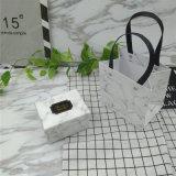Regarder l'emballage du papier Boîte avec sac, boîte de carton de l'impression