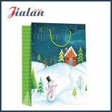 La promotion en gros 4c a estampé le sac de cadeau de papier de Noël de modèle de bonhomme de neige