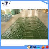 El PVC del color verde cubrió la cubierta del acoplado del encerado