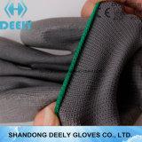 Qualité fonctionnant les gants gris de travail d'unité centrale