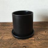 Pequeña Maceta de cerámica negro mate con platillo