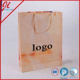 Bolso impreso insignia por encargo del regalo del papel de la marca de fábrica para las ventas al por mayor de las compras