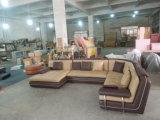 Sofà della mobilia del salone con il sofà d'angolo di cuoio