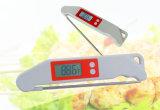 Момент времени цифров прочитал термометр еды для кухни с вилкой