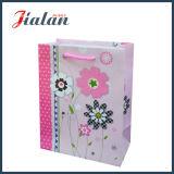 Rétro série avec le sac de papier de achat de cadeau de transporteur de fleurs de lotus