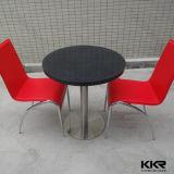 Jogos internos de pedra pretos redondos da tabela para 2 Seater