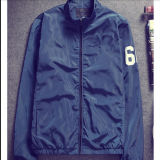 100%年のポリエステル/ナイロン軽量のウインドブレイカーのジャケット/防風の冬のジャケット