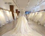 花嫁のレースのキャミソールの深いV首のホローバックにBeadingsの長い袖のAラインの弓ウエストの錯覚の安いウェディングドレス中国製