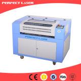 Precio de la cortadora del grabado del laser del CO2 del anillo de madera de Hotsale 6040 buen