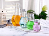 La forme d'ampoule vide bouteille en verre avec bouchon en métal