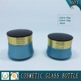 青い装飾的なガラスローションポンプびんおよび化粧品の贅沢の瓶
