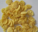 Aufblasen der Reis-Corn- FlakesFrühstückskost aus Getreide, die Maschine herstellt