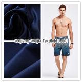 衣服Hometextileまたは衣服のための75D*150dによってブラシをかけられるポリエステルサテンのモモの皮