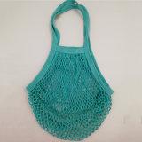 Le azione colorano il sacchetto netto della frutta della maglia del cotone con il contrassegno su ordinazione