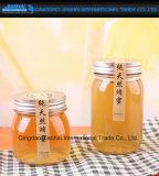 食糧、蜂蜜、ピクルスのための円形の明確なガラス容器