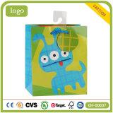 緑の漫画の子供の芸術の上塗を施してあるギフトの紙袋