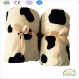 Commercio all'ingrosso molle eccellente della coperta del bambino del panno morbido della flanella di stampa del reticolo della mucca
