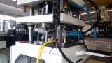 Una máquina que moldea automática del soplo de inyección del paso de progresión para la botella de la PC