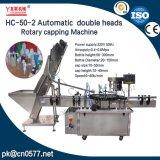 Máquina que capsula rotatoria de los casquillos plásticos dobles de las pistas para los cosméticos (HC-50-2)