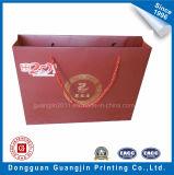 Rojo de alta calidad Bolsa de compras de papel impreso con logotipo de oro