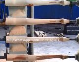 Máquina moldando do punho de madeira do machado