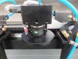 Corte del laser del CO2 del CNC y máquina de grabado con la máquina de la cámara del CCD para la ropa, fábrica del cartón