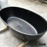 Vasca da bagno indipendente di pietra composita nera della stanza da bagno