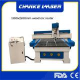 la cortadora de trabajo de madera del CNC de 1300X2500m m para los muebles hace el grabado a mano para corte de metales