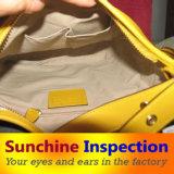Controllo di qualità dell'assegno di cuoio del sacchetto modo/del raccoglitore