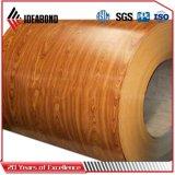 Le regard en bois de finition normal a enduit la bobine d'une première couche de peinture en aluminium
