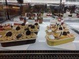 Вкладыш выпечки алюминиевой фольги пирожня магазина выпечки верхнего сегмента цветастый
