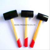 لون سوداء يصنع ميتدة مطّاطة مع مقبض خشبيّة في يد [ره-2]