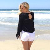 女性の偶然の緩く長い袖のふさのBohoのブラウスのワイシャツの上