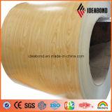 Le regard du bois a enduit la bobine d'une première couche de peinture en aluminium (AE-305)