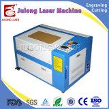 mini máquina de grabado del laser del CO2 50W para el uso de las botellas de cristal del grabado rotatorio