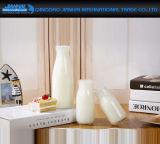 bottiglia per il latte del bambino di vetro di alta qualità 120/180ml con il coperchio a vite
