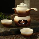 ヒーターが付いている茶鍋を調理する陶磁器のティーセットの陶磁器の沸かされたティーカップ