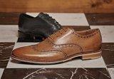 Pattini di vestito dalle calzature del fannullone degli uomini del cuoio genuino della Cina